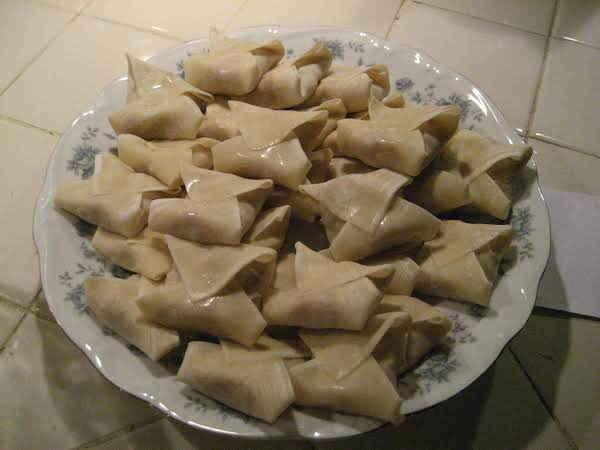 These Are The Uncooked Won Tons, The Cooked Are Golden Brown.