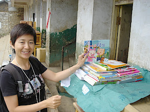 Photo: Fangmaba unpacking children's reading materials in the city of Zhaotong, China