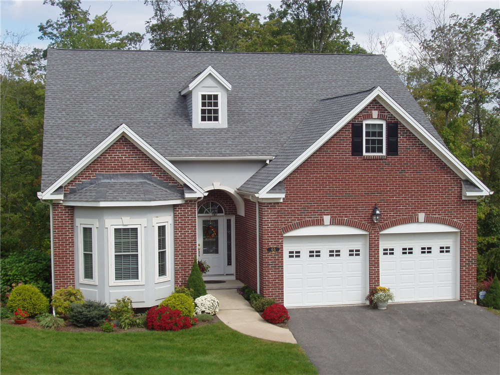 red brick house with 2 garages