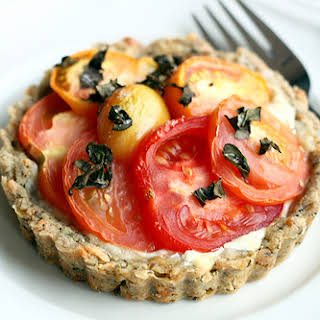 Tomato Goat Cheese Tarts in an Herb Parmesan Crust.