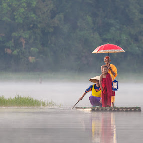 The Monk by Andi Kurniadi - People Street & Candids ( monk, nature, monks, umbrella, lake, candid, people, misty, river )