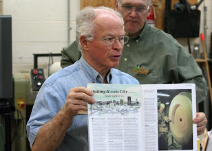Photo: Phil Brown shows an article in the new American Woodturner written by MCW member David Fry about MCW member Mark Supik.