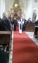 Photo: cesta z kostela v čele s farářem