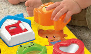 Toddler playing with puzzle