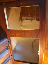 Photo: looking into starboard, aft lower locker with drawer hardware removed.