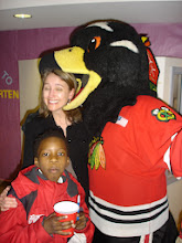 """Photo: """"Tommy Hawk"""" nearly takes a bite out of Executive Director Erin McPartlin."""
