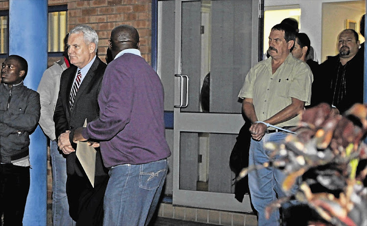 Cato Manor Organised Crime Unit head Major-General Johan Booysen and Hawks officer Captain Eugene van Tonder under arrest. File photo.