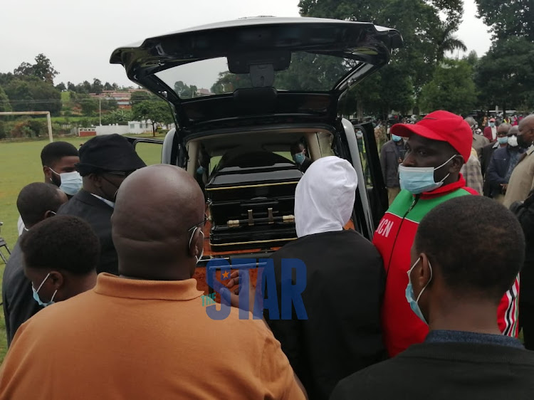 Simeon Nyachae's body being loaded into a hearse at Kisii School./ANGWENYI GICHANA