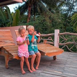 Checking by Geoffrey Wols - Babies & Children Toddlers ( seat, sunset, girl, boy, photos, kids,  )