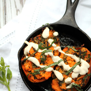 Goats Cheese & Kale Stuffed Sweet Potatoes With Tahini Yogurt Sauce