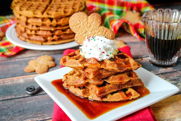 Gingerbread Waffles With Syrup, Whipped Cream, And A Cookie.