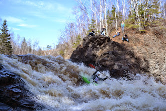 Photo: An unidentified kayaker makes his way down one of the larger rapids on the Lester River as spectators look on.