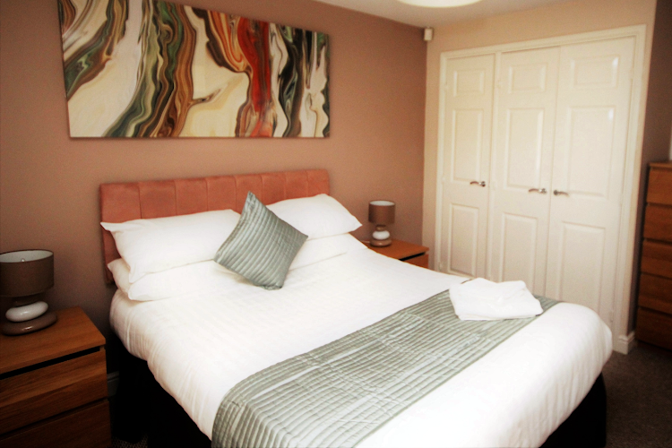 Luxury bedroom at Knightsbridge Court PU