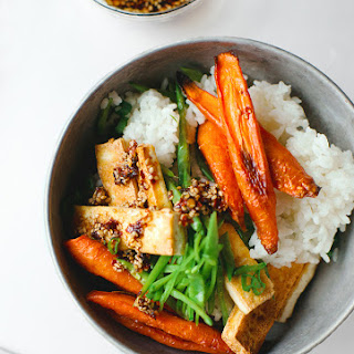 CRISPY TOFU WITH ROASTED CARROTS AND SNOW PEAS.
