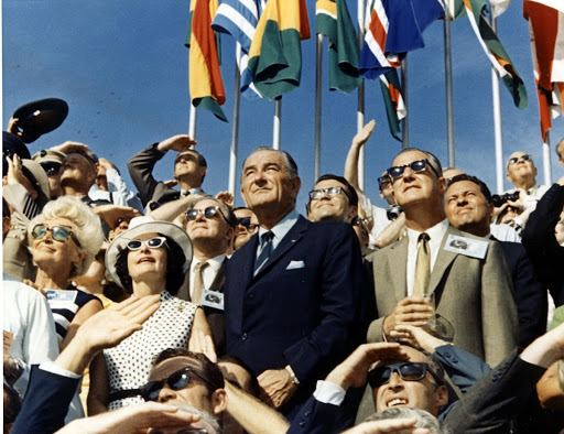 Spiro Agnew and Lyndon Johnson view the liftoff of Apollo 11 from the stands located at the Kennedy Space Center VIP viewing site.
