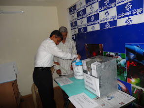 Photo: Dr. JP dropping the Ballot in the Ballot Box - GHMC Elections