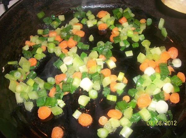In same skillet, add carrots, celery and scallions and saute for 3 minutes, stirring...