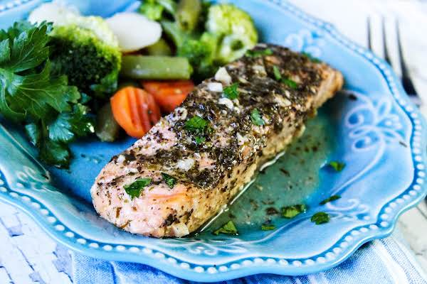 A Piece Of Easy Baked Salmon On A Plate With Veggies.