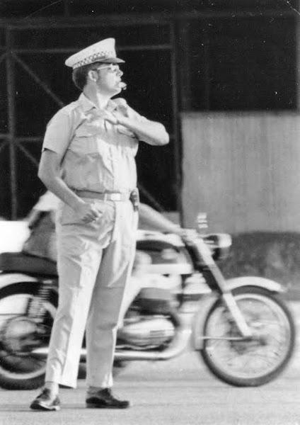 Photo: Lynn Cox directing traffic in Darwin in the 1970's - NT Police