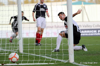 Photo: Falkirk v Dunfermline Athletic Irn Bru First Division The Falkirk Stadium 6 October 2012Andy Barrowman slides the ball into the net(c) Craig Brown | StockPix.eu