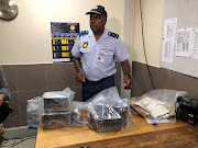 Police spokesperson Brig Vish Naidoo with some of the drugs sized at OR Tambo international airport.