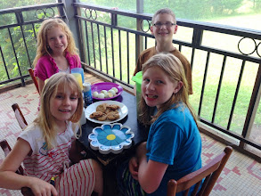 Photo: Our kids enjoying a picnic on the front porch