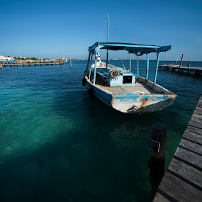 Boat at Isla Mujeres by Cristobal Garciaferro Rubio - Transportation Boats ( shore, water, wood dock, sea, boat, dock )