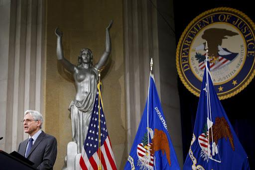 DOJ faces criticism for defending President Trump