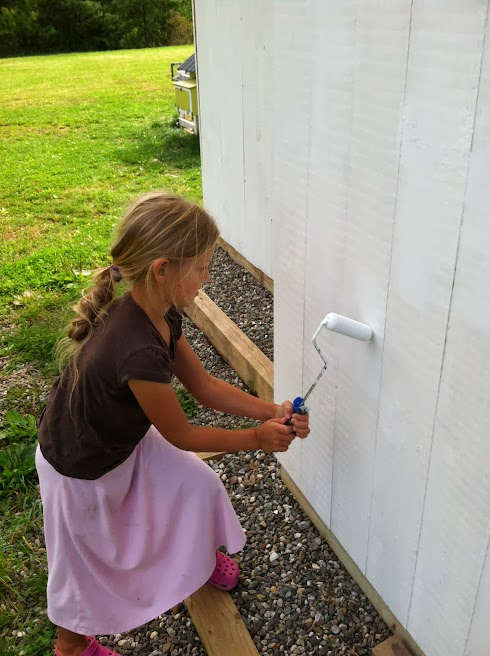 Child labor yay! Priming knots on shed