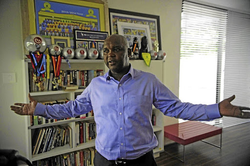 Mamelodi Sundowns coach Pitso Mosimane at his home in Johannesburg. The champion coach speaks about his job, life in football and thoughts about his image dominating memes on Twitter (instert).
