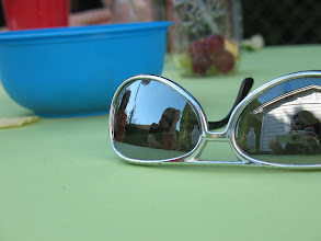 Photo: I am quite fond of photos taken with reflective surfaces. Here is a reflection of my dear friend, Tiger Reel.