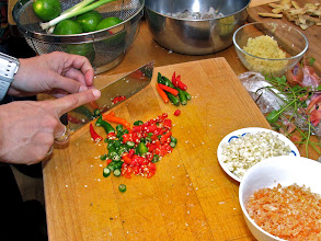 Photo: cutting Thai chillies