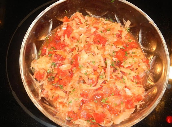 In a large bowl, place sauerkraut, drained tomatoes, minced onion, bacon parsley, celery seeds,...