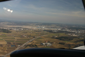 Photo: Approaching the airport (visible in the center and left side of the picture) http://www.swiss-flight.net