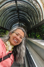 Photo: Florine on escalator leading up to the town