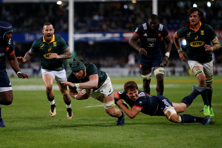France's Antoine Dupont  tackles Springboks captain Warren Whitely at Kings Park Stadium in  Durban on Saturday. Picture: REUTERS