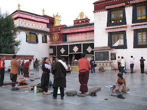 Photo: pilgrims prostrating in front of Jokhang
