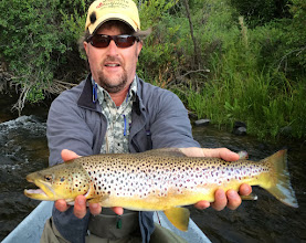 Photo: Here's Brian from yesterday on the Madison River in Montana. A pig on a dry....the famous Fat Albert. They got out early and had incredible dry fly fishing on the nocturnal stoneflies which the Fat Albert fly does a great job of imitating. Day off today so all are headed to Yellowstone for some sight-seeing and fishing.