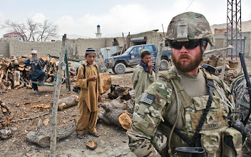 Photo: U.S. Army Sgt. Thomas Becker of the 307th Military Information Support Operations Company, 10th MISO Battalion, Missouri Reserve Unit, provides security in the village of Orgun in Paktika province, Afghanistan, July 10, 2011.