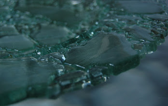 Photo: Requirements 2 & 5 (midground focus & man-made object): This photo is of a fused glass plate made from recycled glass chunks. The midground focus clearly shows some of the textures of the plate while leaving other aspects blurry. Post-processing: cropped.