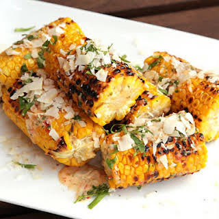 Grilled Corn with Spicy Chili Mayo, Coconut, and Fish Sauce.