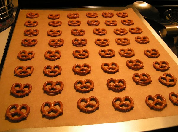 Arrange the pretzels in a single layer on a parchment lined cookie sheet. Place...