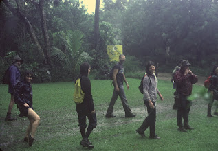 Photo: Just down from Pu'u Manamana early 80s. Behind the leg at left: Dick Booth, in front of yellow sign, Wes (can't recall his last name)