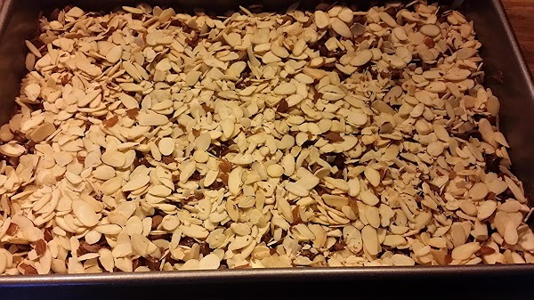 Top chocolate chips with 1 cup almonds
