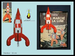 """Photo: La fusée des aventures de Tintin  """"On a marché sur la lune"""""""