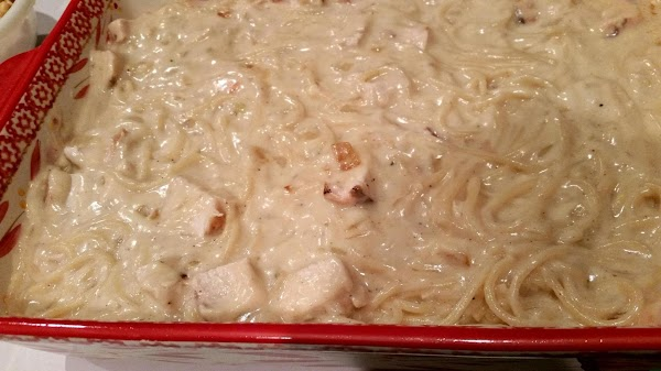 Preheat oven to 350 degree F. Grease a 9 x 13 baking dish.  Stir in...
