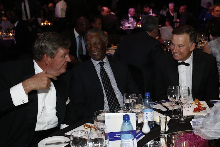 Former president Thabo Mbeki is all smiles in this recent picture with Johann Rupert  and Times Media CEO Andrew Bonamour. But it wasn't always so. Picture: TIMES MEDIA