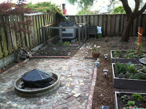 Photo: Fire bowl, Coop, and Planters complete with solar garden lighting.
