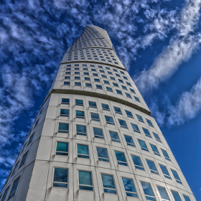 Screwed by Buffan Walter - Buildings & Architecture Architectural Detail ( clouds, sweden, blue, turning torso, reflections, architectural detail, windows, architecture, weird angle, angle, malm,  )