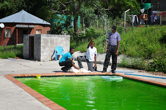 Photo: I think the water is supposed to be blue! Samuel and friends trying to rectify the problem.